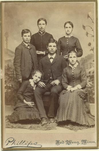 The other half of the family: David, Alice, Eva (standing) and Hulda, Willie, and Anna (seated)