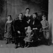 The Andersons in about 1876 after they were reunited in America::Ida, Gustaf, Emma, Johann, and Josef. Unknown young child.