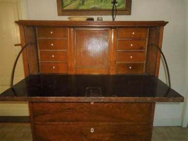 It contains a drop-down desk. The chest/desk still exists at the home of Karl Erik Olsson in Vἄstra Hἄglinge in Sweden.